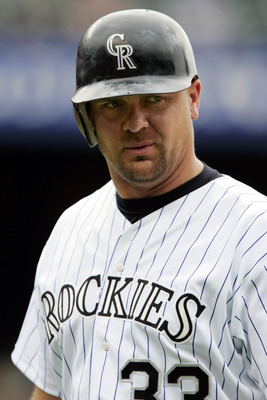 DENVER - JULY 4:  Larry Walker #33 of the Colorado Rockies walks back to the dugout after pinch-hitting against the Detroit Tigers on July 4, 2004 at Coors Field in Denver, Colorado. The Rockies came from behind to sweep the Tigers with a 10-8 win.  (Phot