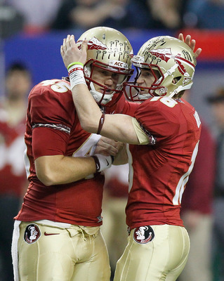 ATLANTA, GA - DECEMBER 31:  Dustin Hopkins #18 of the Florida State Seminoles reacts after kicking a field goal against the South Carolina Gamecocks with Shawn Powell #45 during the 2010 Chick-fil-A Bowl at Georgia Dome on December 31, 2010 in Atlanta, Ge