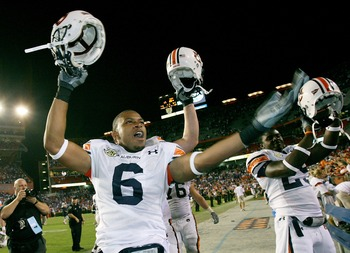 GAINESVILLE, FL - SEPTEMBER 29:  Walter McFadden #6 and Ryan Williams #25 of the Auburn Tigers celebrate after defeating the Florida Gators at Ben Hill Griffin Stadium September 29, 2007 in Gainesville, Florida. Auburn defeated Florida 20-17.  (Photo by D