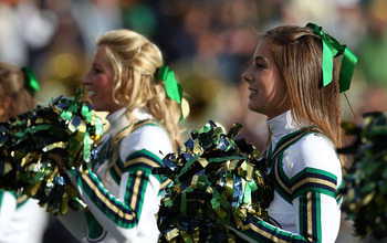 SOUTH BEND, IN - OCTOBER 30: Cheerleaders for the Notre Dame Fighting Irish perform during a game against the Tulsa Golden Hurricane at Notre Dame Stadium on October 30, 2010 in South Bend, Indiana. Tulsa defeated Notre Dame 28-27. (Photo by Jonathan Dani