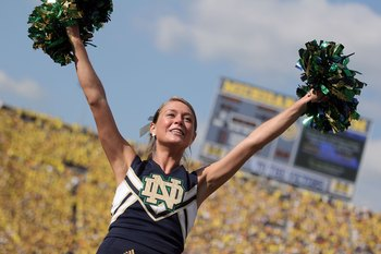 ANN ARBOR, MI - SEPTEMBER 12:  A Notre Dame cheerleader cheers on the visiting crowd against Michigan at Michigan Stadium on September 12, 2009 in Ann Arbor, Michigan.  (Photo by Domenic Centofanti/Getty Images)