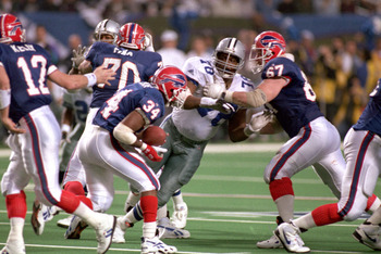 ATLANTA - JANUARY 30:  Defensive tackle Leon Lett #78 of the Dallas Cowboys goes after Buffalo Bills running back Thurman Thomas #34 during Super Bowl XXVIII at the Georgia Dome on January 30, 1994 in Atlanta, Georgia.  The Cowboys won 30-13.  (Photo by G