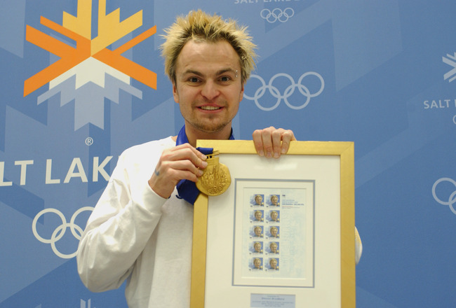 SALT LAKE CITY, UT - FEBRUARY 24:  Steven Bradbury, one of Australia's two gold medalists, poses with his commemorative stamps and gold medal during the Australian Press Conference at the Main Media Center on February 24, 2002 during the Salt Lake Winter