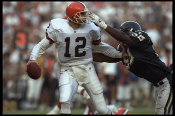 3 Dec 1995:  Quarterback Vinny Testaverde #12 of the Cleveland Browns drops back but is about to be sacked by defensive end Raylee Johnson #99 of the San Diego Chargers in this AFC match up at Jack Murphy Stadium in San Diego, California.  The Chargers de