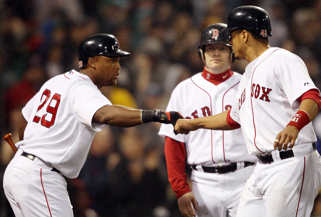 BOSTON - MAY 19:  Adrian Beltre #29 of the Boston Red Sox congratulates teammate Victor Martinez #41 after Martinez scored in the fourth inning against the Minnesota Twins on May 19, 2010 at Fenway Park in Boston, Massachusetts.  (Photo by Elsa/Getty Imag