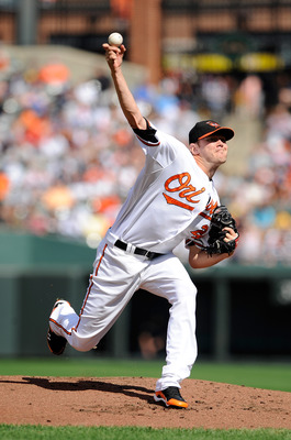BALTIMORE - SEPTEMBER 19:  Chris Tillman #24 of the Baltimore Orioles pitches against the New York Yankees at Camden Yards on September 19, 2010 in Baltimore, Maryland.  (Photo by Greg Fiume/Getty Images)