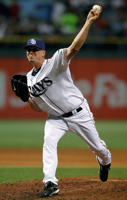 ST. PETERSBURG, FL - SEPTEMBER 14:  Pitcher Jake McGee #57 of the Tampa Bay Rays pitches against the New York Yankees during the game at Tropicana Field on September 14, 2010 in St. Petersburg, Florida.  (Photo by J. Meric/Getty Images)