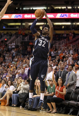 O.J. Mayo #32 of the Memphis Grizzlies puts up a shot during the NBA game against the Phoenix Suns at US Airways Center on November 5, 2010 in Phoenix, Arizona. NOTE TO USER: User expressly acknowledges and agrees that, by download