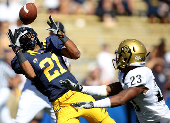 BERKELEY, CA - SEPTEMBER 11: Keenan Allen #21 of the California Golden Bears can't catch a pass as Jalil Brown #23 of the Colorado Buffaloes defends at California Memorial Stadium on September 11, 2010 in Berkeley, California. (Photo by Jed Jacobsohn/Gett