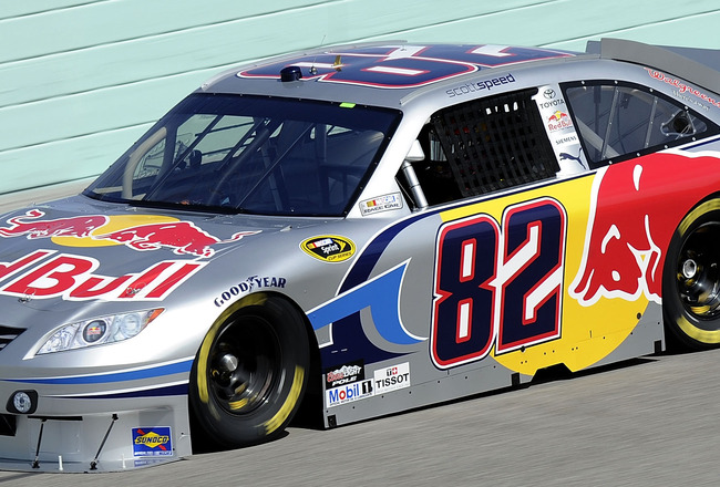 HOMESTEAD, FL - NOVEMBER 19:  Scott Speed, driver of the #82 Red Bull Toyota, practices for the NASCAR Sprint Cup Series Ford 400 at Homestead-Miami Speedway on November 19, 2010 in Homestead, Florida.  (Photo by John Harrelson/Getty Images for NASCAR)