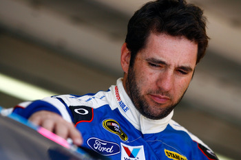 AVONDALE, AZ - NOVEMBER 12:  Elliott Sadler, driver of the #19 Paralyzed Veterans of America Ford, stands in the garage during practice for the NASCAR Sprint Cup Series Kobalt Tools 500 at Phoenix International Raceway on November 12, 2010 in Avondale, Ar