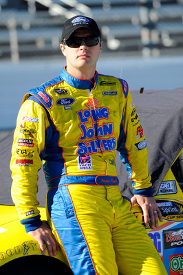 MARTINSVILLE, VA - OCTOBER 22:  Travis Kvapil, driver of the #38 Long John Silver's Ford, stands on pit road during qualifying for the NASCAR Sprint Cup Series TUMS Fast Relief 500 at Martinsville Speedway on October 22, 2010 in Martinsville, Virginia.  (