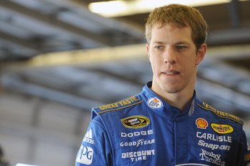 DAYTONA BEACH, FL - JANUARY 22:  Brad Keselowski, driver of the #2 Miller Lite Dodge, stands in the garage area during testing at Daytona International Speedway on January 22, 2011 in Daytona Beach, Florida.  (Photo by Jared C. Tilton/Getty Images for NAS