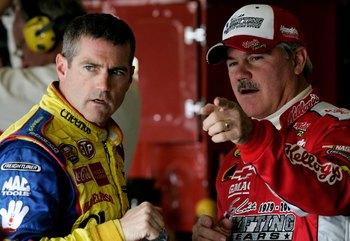 FORT WORTH, TX - NOVEMBER 04:  Bobby Labonte, driver of the #43 Cheerios/Betty Crocker Dodge, talks with his brother Terry labonte, driver of the #44 Kellogg's Chevrolet, during practice for the NASCAR Nextel Cup Series Dickies 500, on November 4, 2006 at
