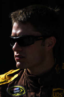 HOMESTEAD, FL - NOVEMBER 20:  David Ragan, driver of the #6 UPS Ford, walks in the garage area during practice for the NASCAR Sprint Cup Series Ford 400 at Homestead-Miami Speedway on November 20, 2010 in Homestead, Florida.  (Photo by Chris Trotman/Getty