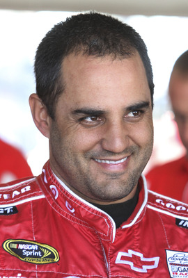 DAYTONA BEACH, FL - JANUARY 20:  Juan Pablo Montoya, driver of the #42 TARGET Chevrolet, waits in the garage during teating at Daytona International Speedway on January 20, 2011 in Daytona Beach, Florida.  (Photo by Jerry Markland/Getty Images for NASCAR)