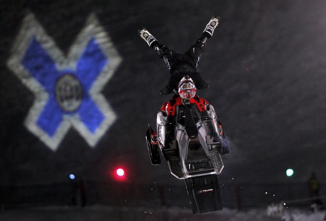 ASPEN, CO - JANUARY 28:  Daniel Bodin of Malung, Sweden, does an aerial maneuver en route to finishing fourth in the inaugural Snowmobile Freestyle at the ESPN Winter X Games 11 January 28, 2007 in Aspen, Colorado.  (Photo by Doug Pensinger/Getty Images)