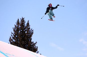 ASPEN, CO - JANUARY 28:  Kaya Turski of Canada does an aerial maneuver as she descends the course to win the Women's Skiing Slopestyle Finals during Winter X Games 14 at Buttermilk Mountain on January 28, 2010 in Aspen, Colorado.  (Photo by Doug Pensinger