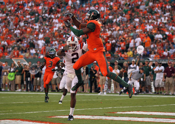 MIAMI - NOVEMBER 20: Leonard Hankerson #85 of the Miami Hurricanes catches a touchdown over Davon Morgan #2 of the Virginia Tech Hokies at Sun Life Stadium on November 20, 2010 in Miami, Florida.  (Photo by Mike Ehrmann/Getty Images)