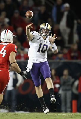 TUCSON, AZ - OCTOBER 23:  Quarterback Jake Locker #10 of the Washington Huskies drops back to pass during the college football game against the Arizona Wildcats at Arizona Stadium on October 23, 2010 in Tucson, Arizona. The Wildcats defeated the Huskies 4