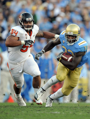 PASADENA, CA - NOVEMBER 06:  Derrick Coleman #33 of the UCLA Bruins runs away from Stephen Paea #54 of the Oregon State Beavers during the second quarter at the Rose Bowl on November 6, 2010 in Pasadena, California.  (Photo by Harry How/Getty Images)
