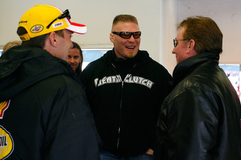 DAYTONA BEACH, FL - FEBRUARY 13:  MMA fighter Brock Lesnar(C)  speaks with Kevin Harvick(L), driver of the #29 Shell/Pennzoil Chevrolet, and team owner Richard Childress during practice for the Daytona 500 at Daytona International Speedway on February 13,