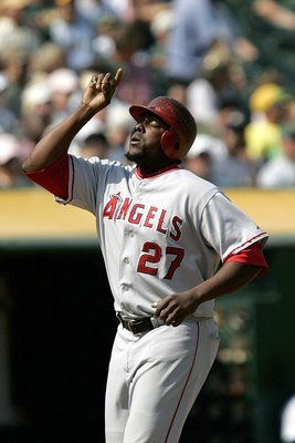 OAKLAND, CA  - SEPTEMBER 24:  Los Angeles Angles Vladimir Guerrero #27 points to the sky as he crosses home plate after hitting a 2 run homerun in the 6th inning as the Oakland A's host the Los Angeles Angeles at McAfee Coliseum on September 24, 2006 in O