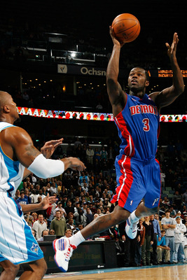 NEW ORLEANS - DECEMBER 16:  Rodney Stuckey #3 of the Detroit Pistons makes a shot over David West #30 of the New Orleans Hornets at New Orleans Arena on December 16, 2009 in New Orleans, Louisiana.  The Hornets defeated the Pistons 95-87. NOTE TO USER: Us