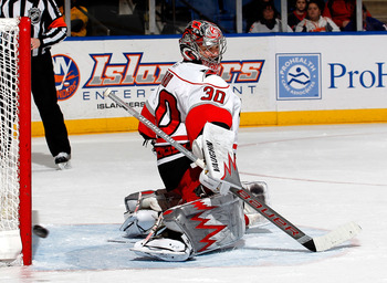 UNIONDALE, NY - JANUARY 26: Goalie Cam Ward #30 of the Carolina Hurricanes turns to see a shot by the New York Islanders hit the post during the second period of an NHL hockey game at the Nassau Coliseum on January 26, 2011 in Uniondale, New York.  (Photo