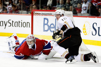 MONTREAL, CANADA - JANUARY 22:  Corey Perry #10 of the Anaheim Ducks collides with Carey Price #31 of the Montreal Canadiens during the NHL game at the Bell Centre on January 22, 2011 in Montreal, Quebec, Canada.  The Ducks defeated the Canadiens 4-3 in a