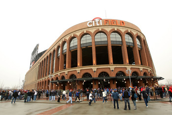 FLUSHING, NY - MARCH 29:  Spectators wait to get in the new Citi Field before the game between the Georgetown Hoyas and St. John's Red Storm on March 29, 2009 in the Flushing neighborhood of the Queens borough of New York City. This is the first event to