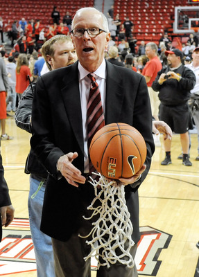 LAS VEGAS - MARCH 13:  Head coach Steve Fisher of the San Diego State Aztecs leaves the court carrying a basketball and the net that was cut down after the Aztecs defeated the UNLV Rebels 55-45 in the championship game of the Conoco Mountain West Conferen