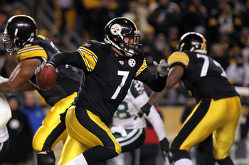 PITTSBURGH, PA - JANUARY 23:  Quarterback Ben Roethlisberger #7 of the Pittsburgh Steelers runs with the ball against the Pittsburgh Steelers during the 2011 AFC Championship game at Heinz Field on January 23, 2011 in Pittsburgh, Pennsylvania. The Steeler