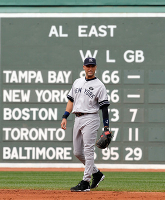 BOSTON - OCTOBER 3:  Derek Jeter #2 of the New York Yankees walks into position during a game against the Boston Red Sox at Fenway Park, October 3, 2010, in Boston, Massachusetts. (Photo by Jim Rogash/Getty Images)