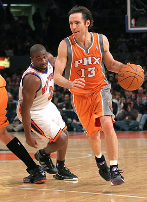 NEW YORK, NY - JANUARY 17:  Steve Nash #13 of the Phoenix Suns drives past Raymond Felton #2 of the New York Knicks at Madison Square Garden on January 17, 2011 in New York City. NOTE TO USER: User expressly acknowledges and agrees that, by downloading an