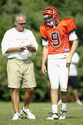 GEORGETOWN, KY - JULY 28:  Quarterback Carson Palmer #9 and offensive coordinator Bob Bratkowski of the Cincinnati Bengals talk during training camp at Georgetown College on July 28, 2003 in Georgetown, Kentucky. (Photo by Andy Lyons/Getty Images)