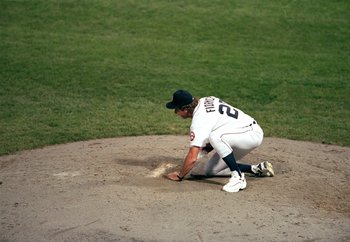 27 Sep 1999: Mark Fidrych of the Detroit Tigers scoops up dirt after the last game played at the Tiger Stadium against the Kansas City Royals in Detroit, Michigan. The Tigers defeated the Royals 8-2. Mandatory Credit: Ezra O. Shaw  /Allsport