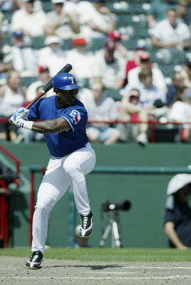 ARLINGTON, TX - APRIL 10:  Ruben Sierra #21 of the Texas Rangers stands at bat during the game against the Oakland Athletics at the Ballpark in Arlington on April 10, 2003 in Arlington, Texas.  The Rangers defeated the A's 5-4.  (Photo by Ronald Martinez/