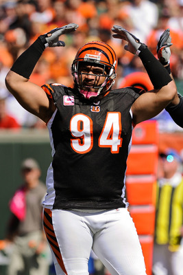 CINCINNATI, OH - OCTOBER 10: Domata Peko #94 of the Cincinnati Bengals rallies the crowd during a game against the Tampa Bay Buccaneers at Paul Brown Stadium on October 10, 2010 in Cincinnati, Ohio. (Photo by Jamie Sabau/Getty Images)