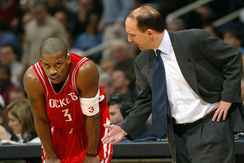 WASHINGTON - JANUARY 13:  Head coach Jeff Van Gundy of the Houston Rockets talks to his teammate Steve Francis #3 during the game against the Washington Wizards at MCI Center on January 13, 2004 in Washington, DC.  The Rockets won 93-80.  NOTE TO USER: Us