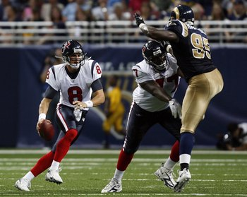 ST. LOUIS - AUGUST 19:  Charles Spencer #77 of the Houston Texans blocks Anthony Hargrove #95 of the St. Louis Rams for teammate David Carr #8 of the Houston Texans on August 19, 2006 at the Edward Jones Dome in St. Louis, Missouri. (Photo by Dilip Vishwa
