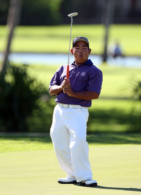 HONOLULU - JANUARY 17:  Tadd Fujikawa reacts to a missed birdie putt on the 14th hole during the third round of the Sony Open at Waialae Country Club on January 17, 2009 in Honolulu, Hawaii.  (Photo by Sam Greenwood/Getty Images)