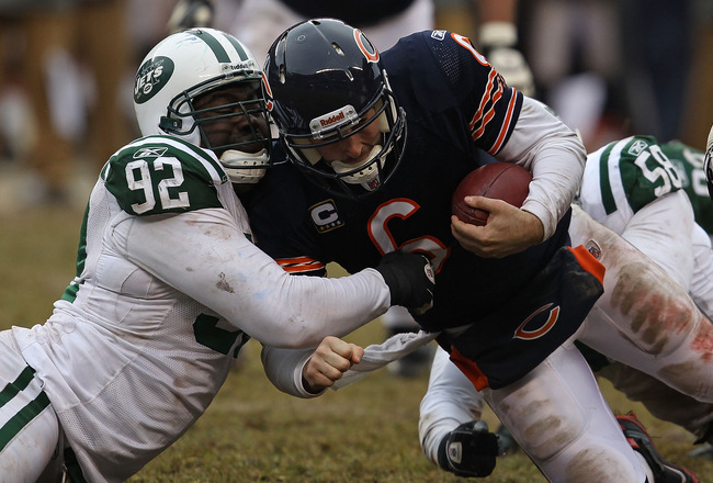 CHICAGO, IL - DECEMBER 26: Jay Cutler #6 of the Chicago Bears is sacked by Shaun Ellis #92 and Bryan Thomas #58 of the New York Jets at Soldier Field on December 26, 2010 in Chicago, Illinois. The Bears defeated the Jets 38-34. (Photo by Jonathan Daniel/G
