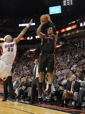 MIAMI, FL - JANUARY 22:  Jerryd Bayless #5 of the Toronto Raptors shoots over Eddie House #55 of the Miami Heat during a game at American Airlines Arena on January 22, 2011 in Miami, Florida. NOTE TO USER: User expressly acknowledges and agrees that, by d
