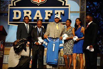 NEW YORK - APRIL 22:  Ndamukong Suh of the Nebraska Cornhuskers holds up a Detroit Lions jersey as he poses with family after he was picked #2 overall by the Lions during the first round of the 2010 NFL Draft at Radio City Music Hall on April 22, 2010 in