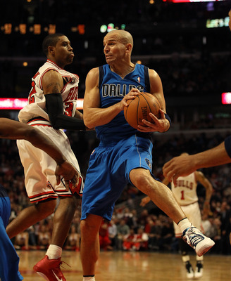 CHICAGO, IL - JANUARY 20: Jason Kidd #2 of the Dallas Mavericks grabs a rebound in front of C.J. Watson #32 of the Chicago Bulls at the United Center on January 20, 2011 in Chicago, Illinois. The Bulls defeated the Mavericks 82-77. NOTE TO USER: User expr