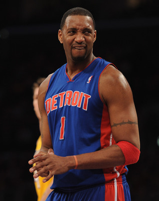 LOS ANGELES, CA - JANUARY 04:  Tracy McGrady #1 of the Detroit Pistons grimaces after a foul against the Los Angeles Lakers at the Staples Center on January 4, 2011 in Los Angeles, California. NOTE TO USER: User expressly acknowledges and agrees that, by