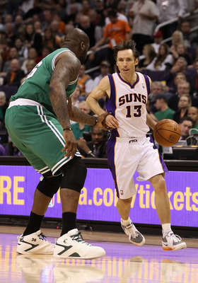 PHOENIX, AZ - JANUARY 28:  Steve Nash #13 of the Phoenix Suns handles the ball guarded by Shaquille O'Neal #36 of the Boston Celtics during the NBA game at US Airways Center on January 28, 2011 in Phoenix, Arizona. The Suns defeated the Celtics 88-71. NOT
