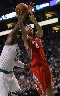 BOSTON, MA - JANUARY 10:  Luis Scola #4 of the Houston Rockets heads for the basket as Glen Davis #11 of the Boston Celtics defends on January 10, 2011 at the TD Garden in Boston, Massachusetts.  The Rockets defeated the Celtics 108-102. NOTE TO USER: Use