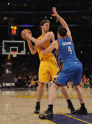 LOS ANGELES, CA - JANUARY 17:  Pau Gasol #16 of the Los Angeles Lakers looks to pass around Nick Collison #4 of the Oklahoma City Thunder at the Staples Center on January 17, 2011 in Los Angeles, California.  (Photo by Harry How/Getty Images)   NOTE TO US